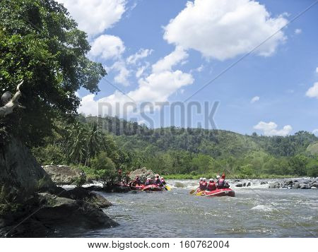 Cagayan de oro Philippines - May 4 2007: People white water rafting Cagayan river Mindanao Philippines. Cagayan River is the most popular site for whitewater rafting in the Philippines.