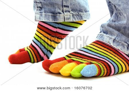 woman legs in strip sock on white background