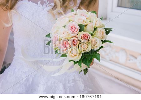 Beautiful wedding bouquet of flowers in hand of the bride