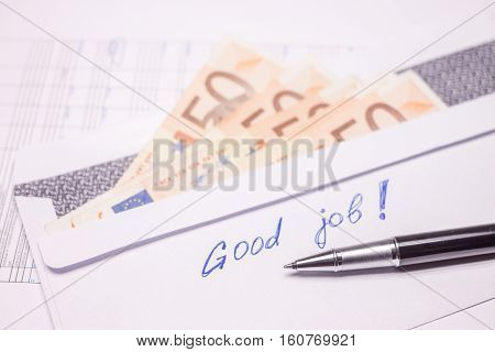 envelope with evro bills and good job sign