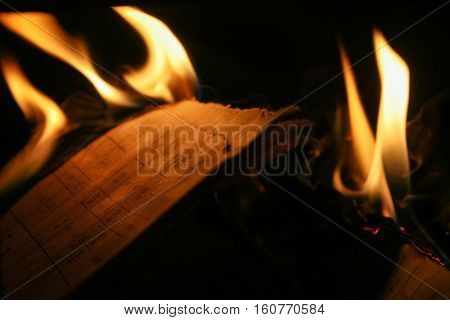 Pages of the book burning in the fireplace