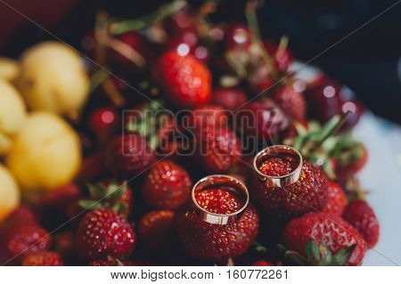 Wedding rings are on the ripe fresh fruit