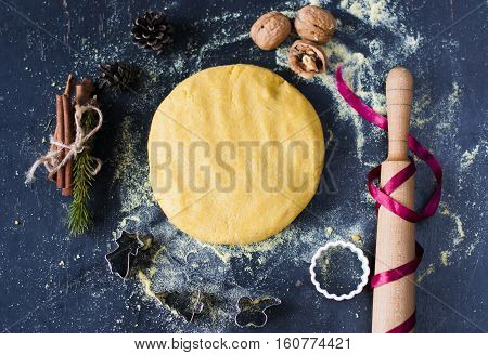 flat lay ingredients for baking with Christmas decoration.