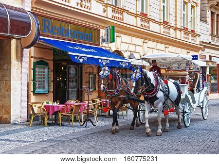 Horse Carriage At Promenade Street In Karlovy Vary