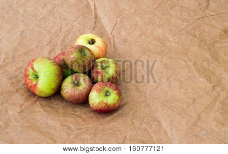 Group Of Fresh Organic Apples On A Craft Paper