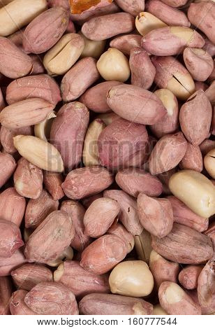 Peanuts with skins in filled frame format.