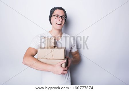 Excited Young Man Holding Presents Isolated On White Background