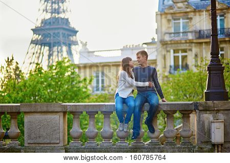 Romantic Loving Couple Near The Eiffel Tower