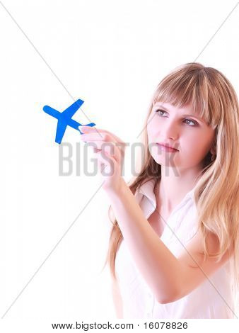 Woman with small aircraft in hands isolated on white