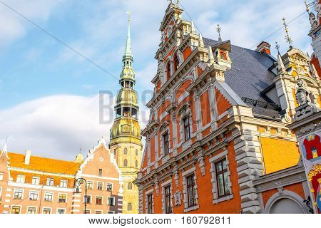 View on the central square with famous house of Blackheads and cathedral tower in Riga city, Latvia