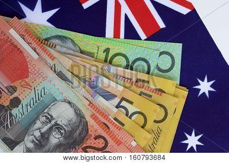 Australian flag with some Australian dollar notes.