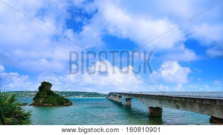Sightseeing View of The Kouri Bridge with blue sky one of the very long bridge in Okinawa Japan