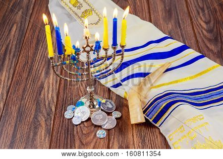 Jewish Holiday Hanukkah With Menorah Over Wooden Table Star David