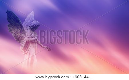Beautiful angel in pink and blue sky concept of religion