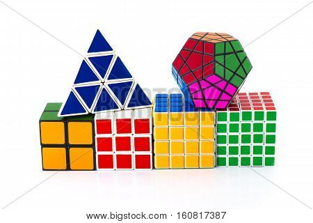 PHRA NAKHON SI AYUTTHAYA THAILAND JUNE 30.Rubik's Cube invented by a Hungarian architect Erno Rubik in 1974.Rubik's cube pyramid and megaminx on a white background. In Phra Nakhon Si Ayutthaya Thailand on 30 June 2015.