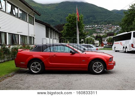 NORDFJORDEYD, NORWAY - JULY 5, 2016: This is cabriolet Ford Mustang Gt Convertible on village street.