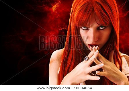 Redhead woman on fire background