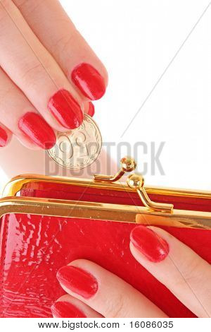 Red wallet and coin in woman hand over white background