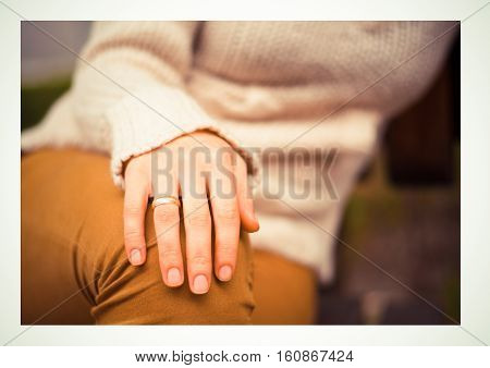 beautiful engagement ring hand woman sitting outdoors