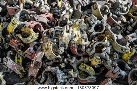 Big pile of scaffolding clamps for assembling at construction site