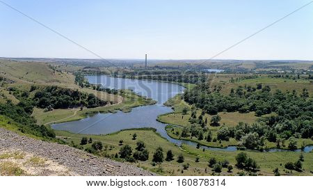 The view from the height of the river, which flows into the reservoir