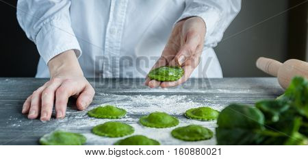 Chef Rolls The Dough For Ravioli