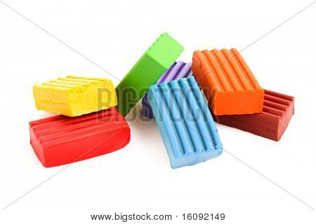 Children bright multicoloured plasticine set chaotically isolated on white