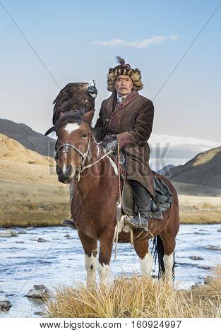 Mongolian Nomad Eagle Hunter On His Hotse