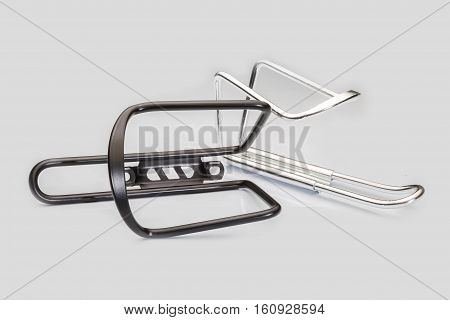 Bicycle's black and silver water bottle clip on a white background