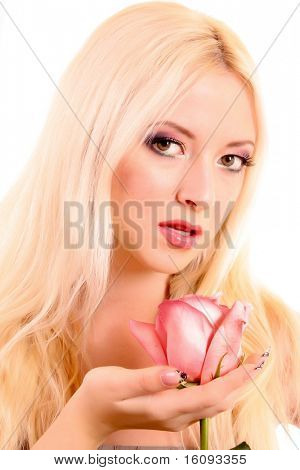 Young beautiful blond woman with fresh pink rose isolated on white