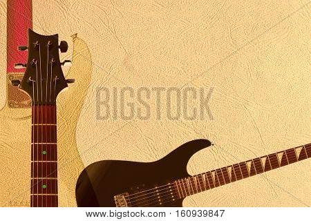 Black electric rock guitar back of guitar body and neck headstock on the light skin background with plenty of copy space.