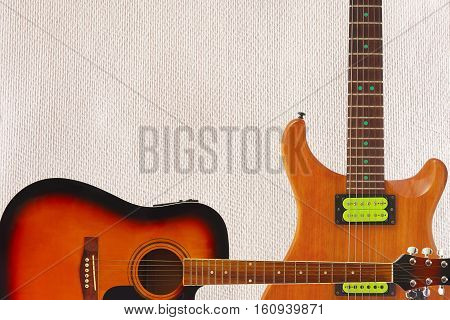 Acoustic and electric guitars on the cardboard background with plenty of copy space.