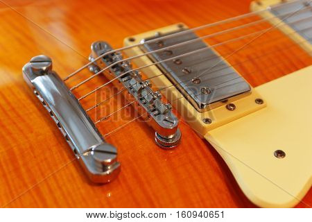 Closeup of the vintage electric guitar. Detail selective focus.