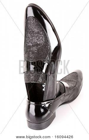 Black shiny man's shoe isolated on white