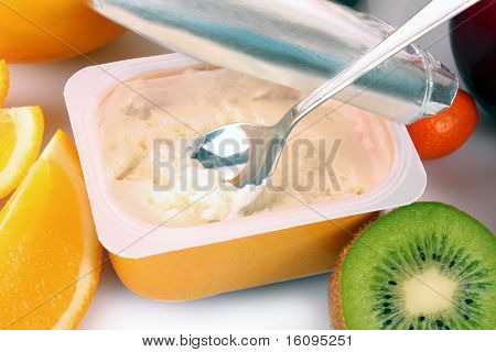 Yoghurt and fruits isolated on white