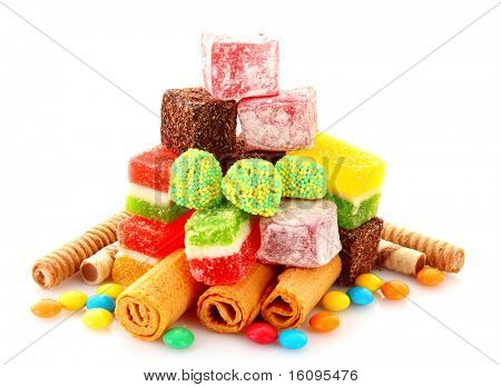 colorful candies jelly on yellow background