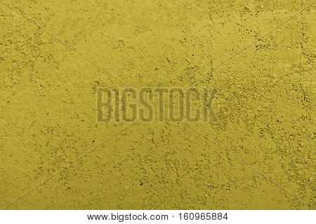 Stucco dark yellow wall background or texture.Plaster, plaster texture, plaster background. Dark yellow wall, dark yellow background.Color plaster.