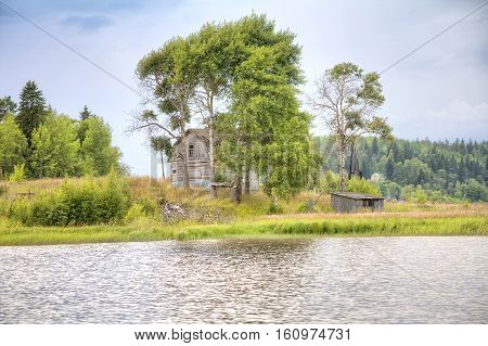Old dwelling-house on verge of settlement ashore the Lake Ladoga