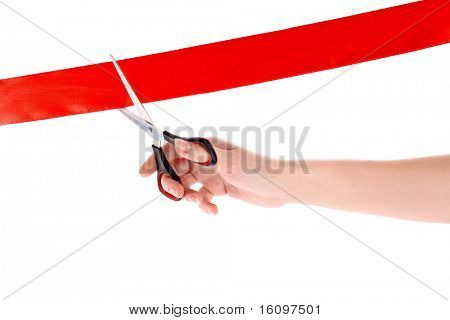 Red ribbon, scissors and hand isolated on white