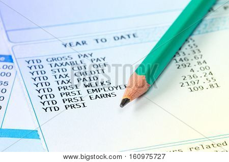 Statement of payroll details with a pencil. Financial accounting concept.