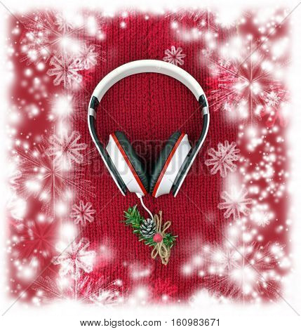 Headphones and a sprig of fir tree with cones on a red knitted scarf. top view. Concept. Music. Winter and walk with music. Christmas tunes. Fashionable life. The festive mood. Youth culture. Snowy winter background.