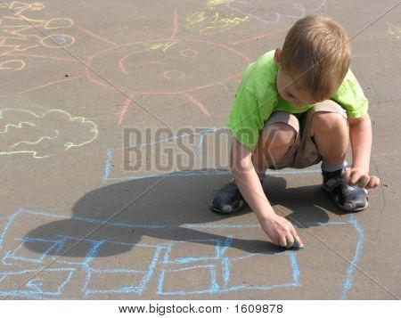 Dibujo de niño sobre asfalto