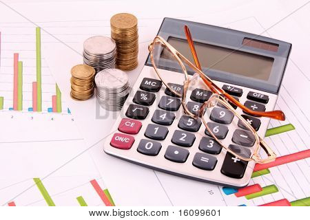 business chart showing financial success, glasses and calculator