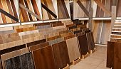 Sample parquet boards in hardware store, in home improvement warehouse exterior poster