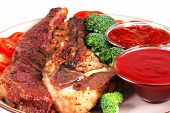 served beef steak with hot chili spicy sauces close up poster
