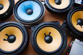 Tweaking audio. Car audio speakers on a work table. poster