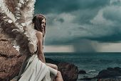 Fine art photo of a woman in white dress as an angel poster