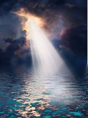 picture of brighten  - Light streams down from above onto tropical sea - JPG
