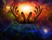 stock photo of cosmic  - High Resolution Hands and light - JPG