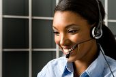 stock photo of rep  - Happy and friendly african american customer service representative - JPG